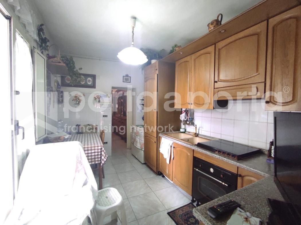 appartamento su due livelli con terrazzi e giardino-4